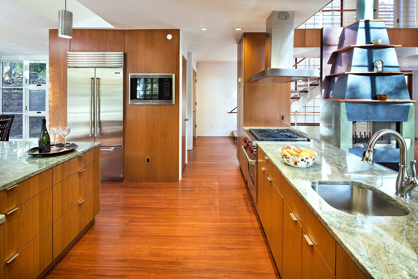 Kitchen, Refrigerator, Cooktops, Range, Range Hood, Microwave, Dishwasher, Granite, Wood, Medium Hardwood, Mosaic Tile, Ceiling, Pendant, Undermount, and Concrete Kitchen  Best Kitchen Range Hood Wood Pendant Mosaic Tile Photos from Home for Sale: Takoma Park House