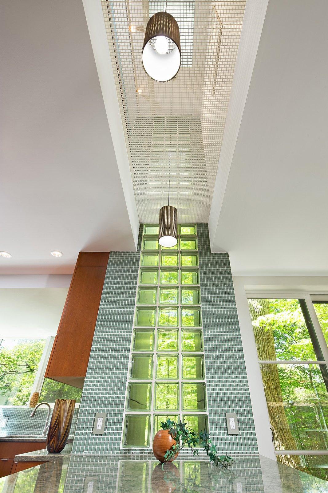Kitchen, Wood Cabinet, Granite Counter, Mosaic Tile Backsplashe, Glass Tile Backsplashe, and Pendant Lighting Ceiling view  Home for Sale: Takoma Park House