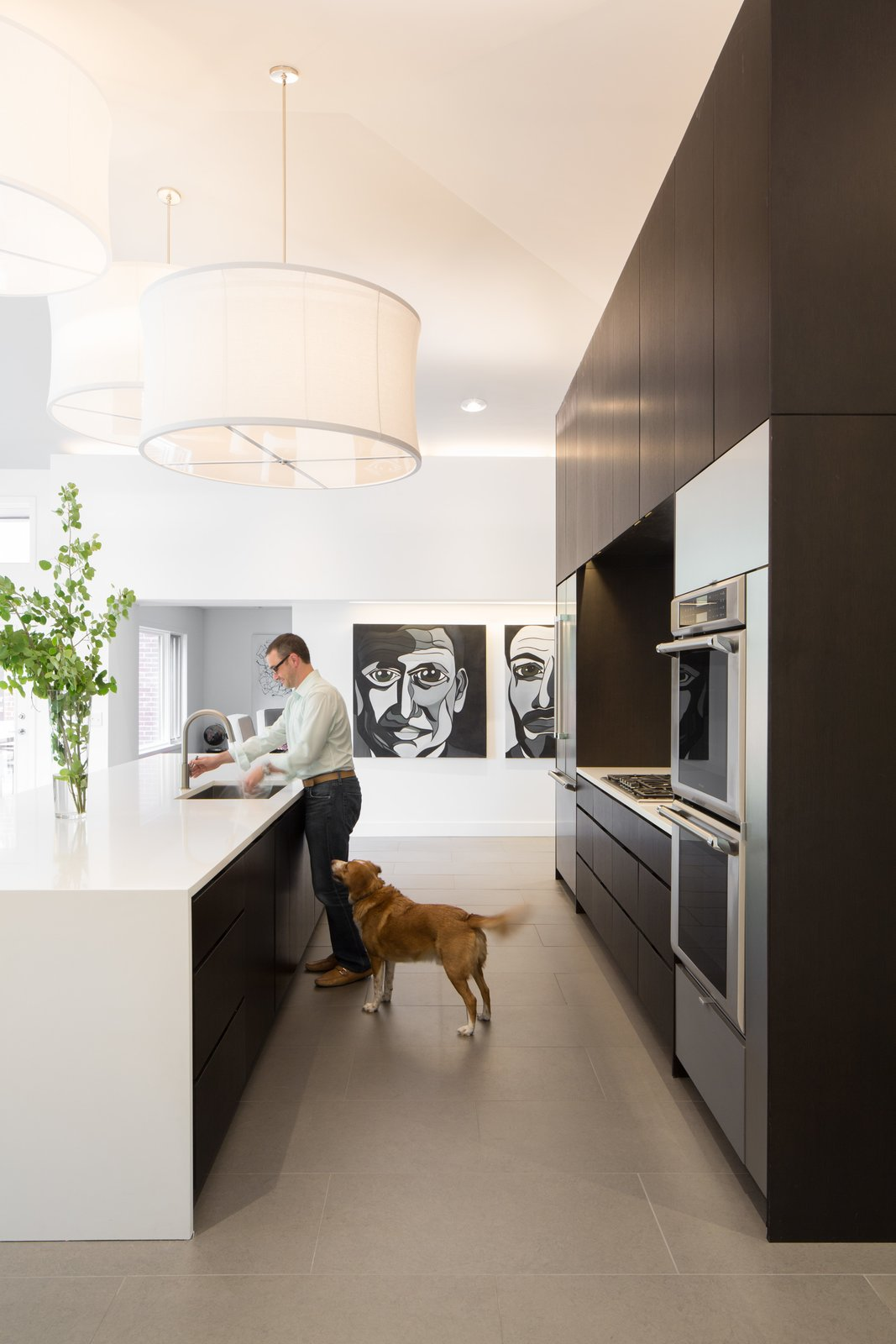 Kitchen, Engineered Quartz Counter, Porcelain Tile Floor, Pendant Lighting, Wood Cabinet, Wall Oven, Refrigerator, and Undermount Sink Kitchen   Donner Residence by Design Platform