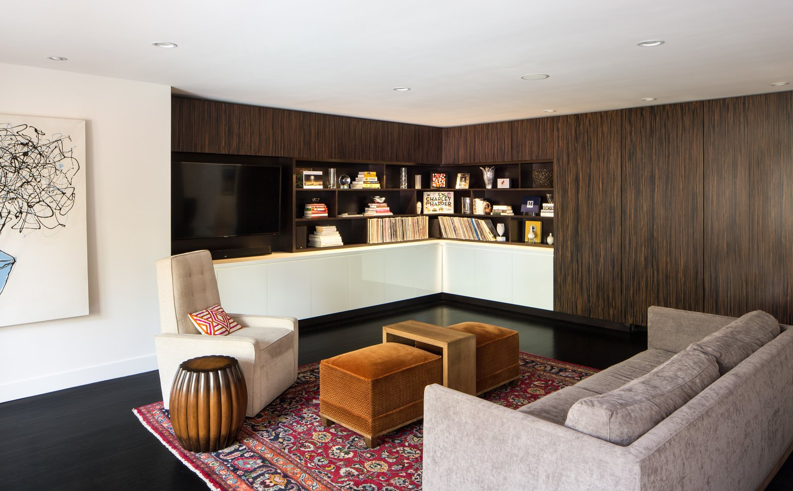Living Room, Media Cabinet, Storage, Bar, Sofa, Chair, Ceiling Lighting, and Dark Hardwood Floor Family Room with Built-In Cabinets and Hidden Bar  Donner Residence by Design Platform