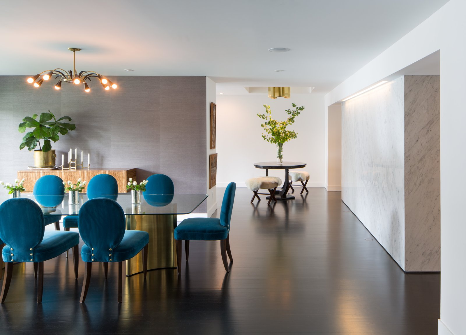 Dining Room, Table, Chair, Pendant Lighting, and Dark Hardwood Floor Dining area looking toward entry. Stone clad kitchen pantry wrap to right.   Donner Residence by Design Platform