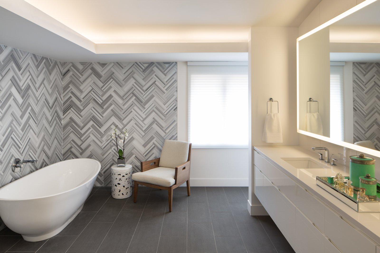 Bath Room, Engineered Quartz Counter, Porcelain Tile Floor, Undermount Sink, Accent Lighting, Freestanding Tub, and Stone Tile Wall Master Bathroom Suite  Donner Residence by Design Platform