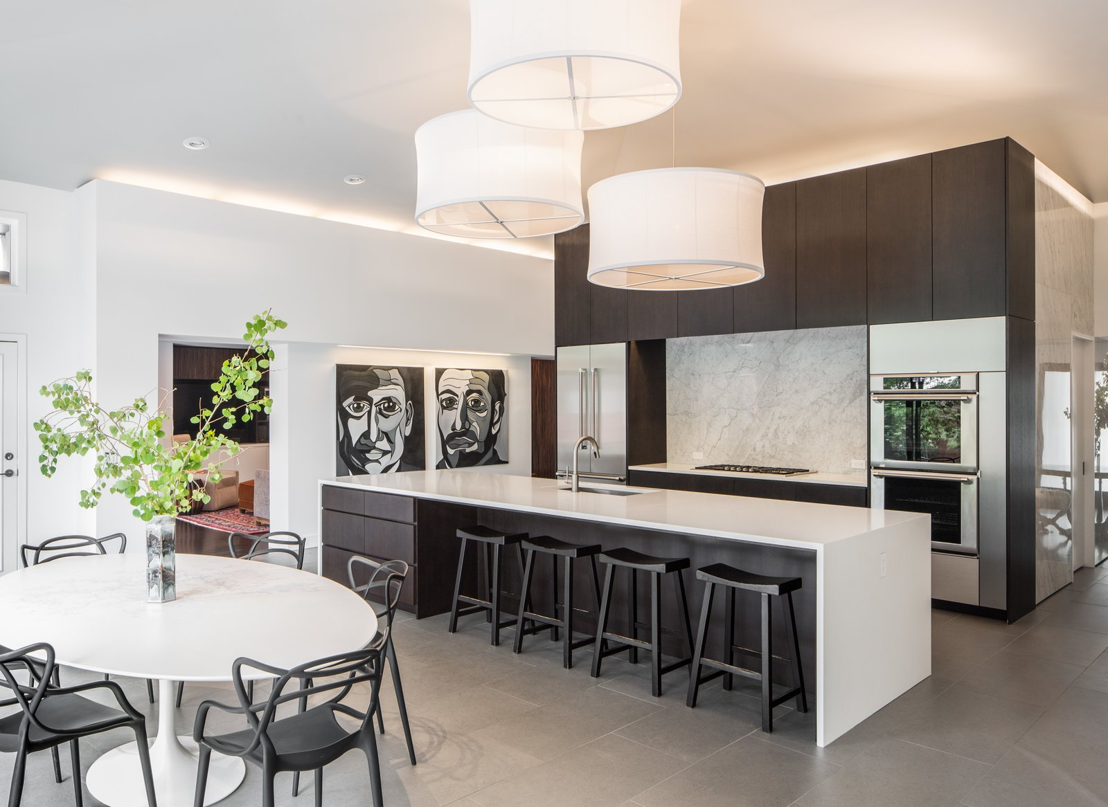 Kitchen, Wood, Porcelain Tile, Stone Slab, Engineered Quartz, Pendant, Refrigerator, Wall Oven, Cooktops, and Undermount Kitchen and Dining Area  Kitchen Undermount Wall Oven Porcelain Tile Photos from Donner Residence