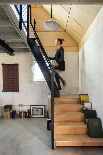 Stairs to Bedroom. Original exposed interior brick. Ships ladder to loft/bedroom. Original loft floor/ceiling. Polished concrete floor below.
