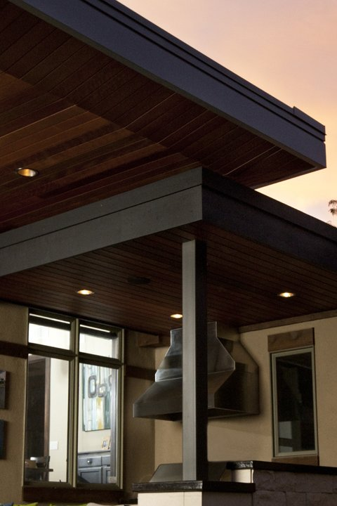 Outdoor, Back Yard, Wood Patio, Porch, Deck, Metal Patio, Porch, Deck, Large Patio, Porch, Deck, and Concrete Patio, Porch, Deck Detail of overlapping roofs.   Hudson Patio