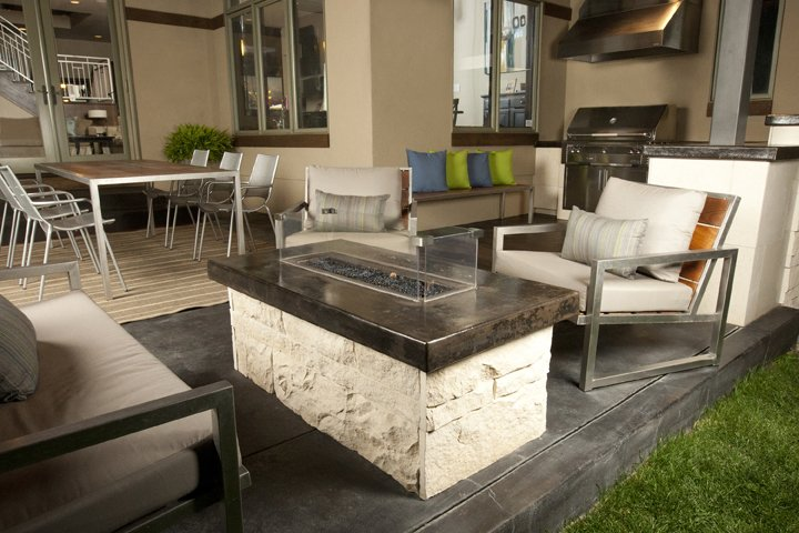 Outdoor, Back Yard, Stone Patio, Porch, Deck, Concrete Patio, Porch, Deck, and Large Patio, Porch, Deck Custom stone and concrete firepit.   Hudson Patio