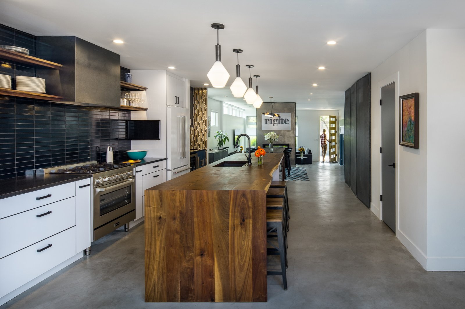 Kitchen, Wood, Pendant, Refrigerator, White, Concrete, Stone Tile, Range, and Undermount Kitchen with live edge walnut island slab  Kitchen Stone Tile White Photos from Lawrence Street Residence
