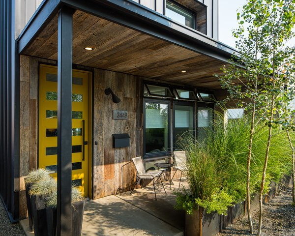 Front Patio area with reclaimed tobacco storage wood facade