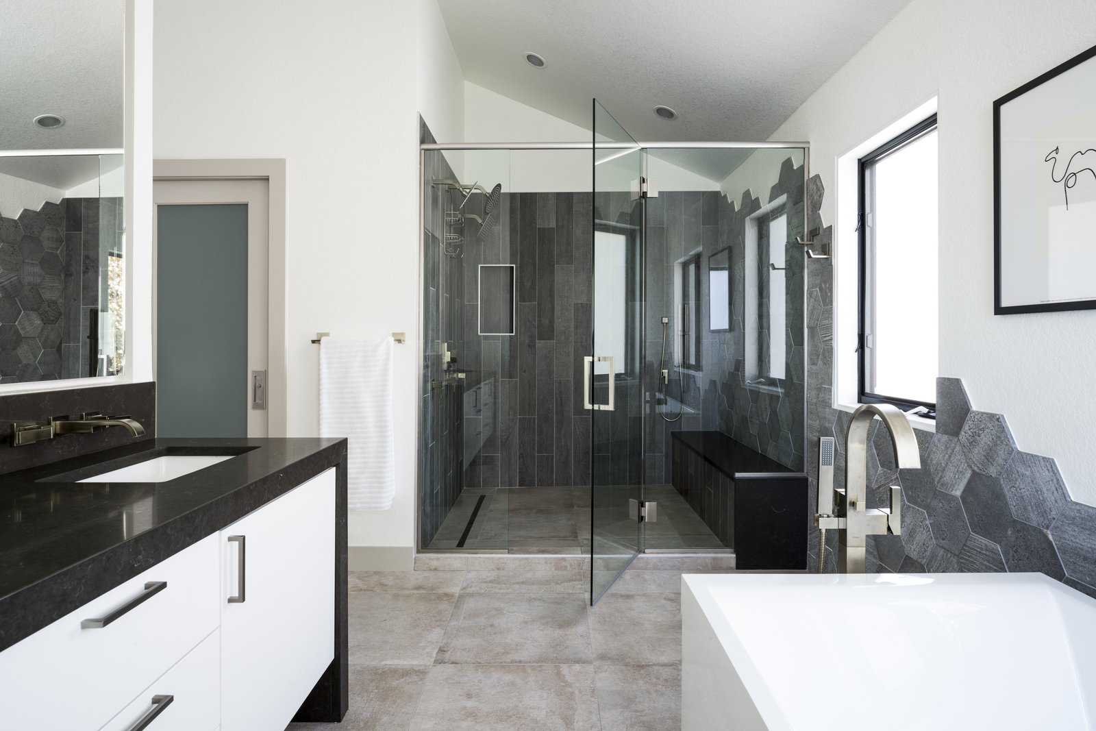 Bath, Porcelain Tile, Porcelain Tile, Freestanding, Undermount, Engineered Quartz, Full, Enclosed, and Recessed Master bathroom suite. Gloss white vanity with dark quartz waterfall countertop. Hexagon tile drops down wall from shower enclosure to tub surround.   Best Bath Recessed Undermount Photos