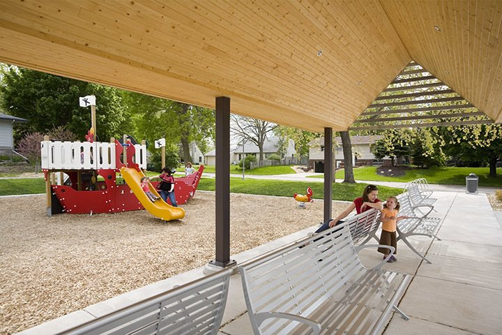 Shade structure adjacent to park playground.  A modern and fresh approach to a small public park in Minnesota.