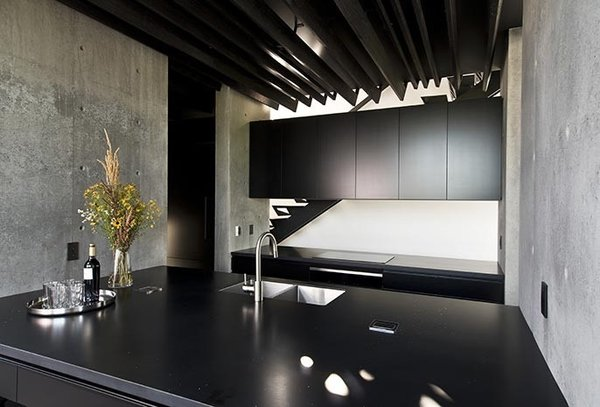 Kitchen, Concrete, Concrete, Track, Refrigerator, Dishwasher, Ceiling, Recessed, Cooktops, Range Hood, Wine Cooler, Microwave, and Drop In Kitchen  Best Kitchen Cooktops Wine Cooler Dishwasher Microwave Ceiling Photos from Kitchen