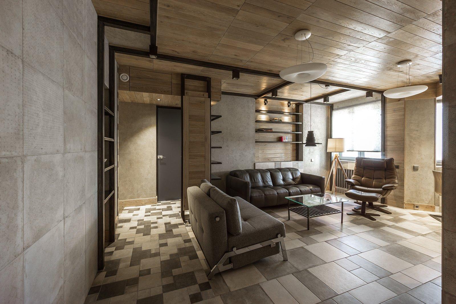 Living Room, Chair, Sofa, Bookcase, Coffee Tables, Floor Lighting, Pendant Lighting, Ceramic Tile Floor, and Ceiling Lighting Living room  NagatinSky by Alexey Rozenberg