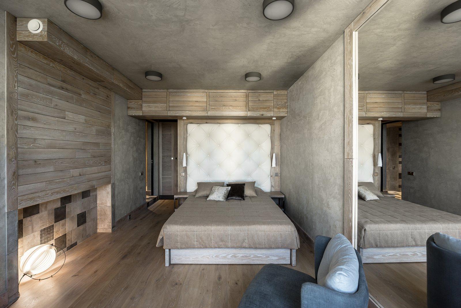 Bedroom, Night Stands, Bed, Chair, Ceiling Lighting, Floor Lighting, Pendant Lighting, and Medium Hardwood Floor Bedroom  NagatinSky by Alexey Rozenberg