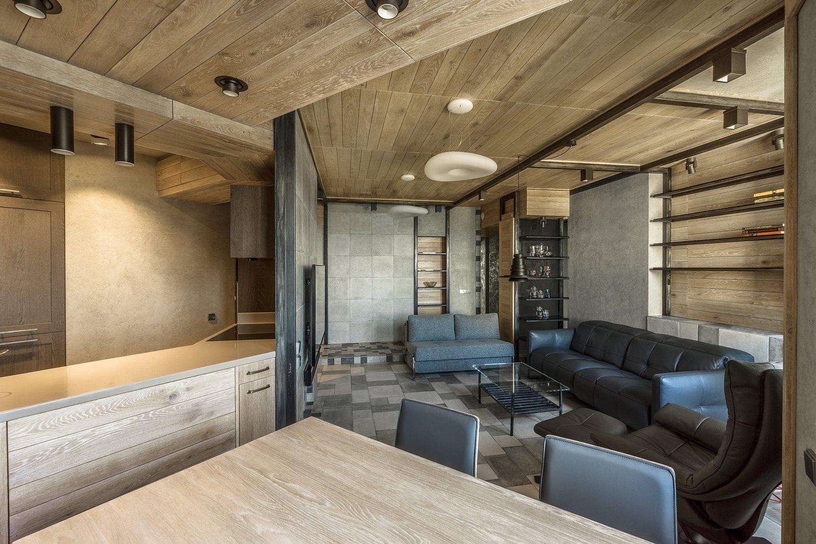 Living Room, Sofa, Coffee Tables, Chair, Ceiling Lighting, Pendant Lighting, and Ceramic Tile Floor Living room  NagatinSky by Alexey Rozenberg
