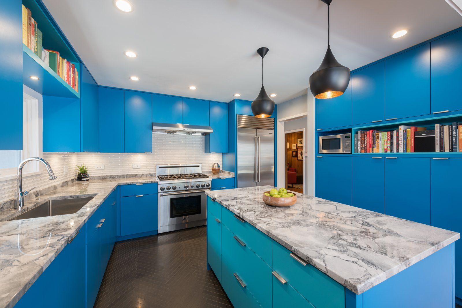 Kitchen, Limestone, Colorful, and Pendant Located in Park Ridge, Illinois, this kitchen renovation gives new life to a midcentury that has been passed down through generations.  Kitchen Limestone Colorful Pendant Photos from Beauty in Blue Park Ridge