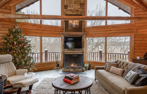 """This install was done by All Seasons Fireplace in Minnesota: """"The homeowners loved the original wood burning fireplace, but their contractor suggested that cutting and carrying wood on a daily basis would get old fast, even with four boys at home to help. They wanted to maintain the large viewing area that the wood burning fireplace allowed, so this Trisore 100H gas fireplace model from European Home was the perfect choice for the room."""""""