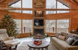 "This install was done by All Seasons Fireplace in Minnesota: ""The homeowners loved the original wood burning fireplace, but their contractor suggested that cutting and carrying wood on a daily basis would get old fast, even with four boys at home to help. They wanted to maintain the large viewing area that the wood burning fireplace allowed, so this Trisore 100H gas fireplace model from European Home was the perfect choice for the room."""