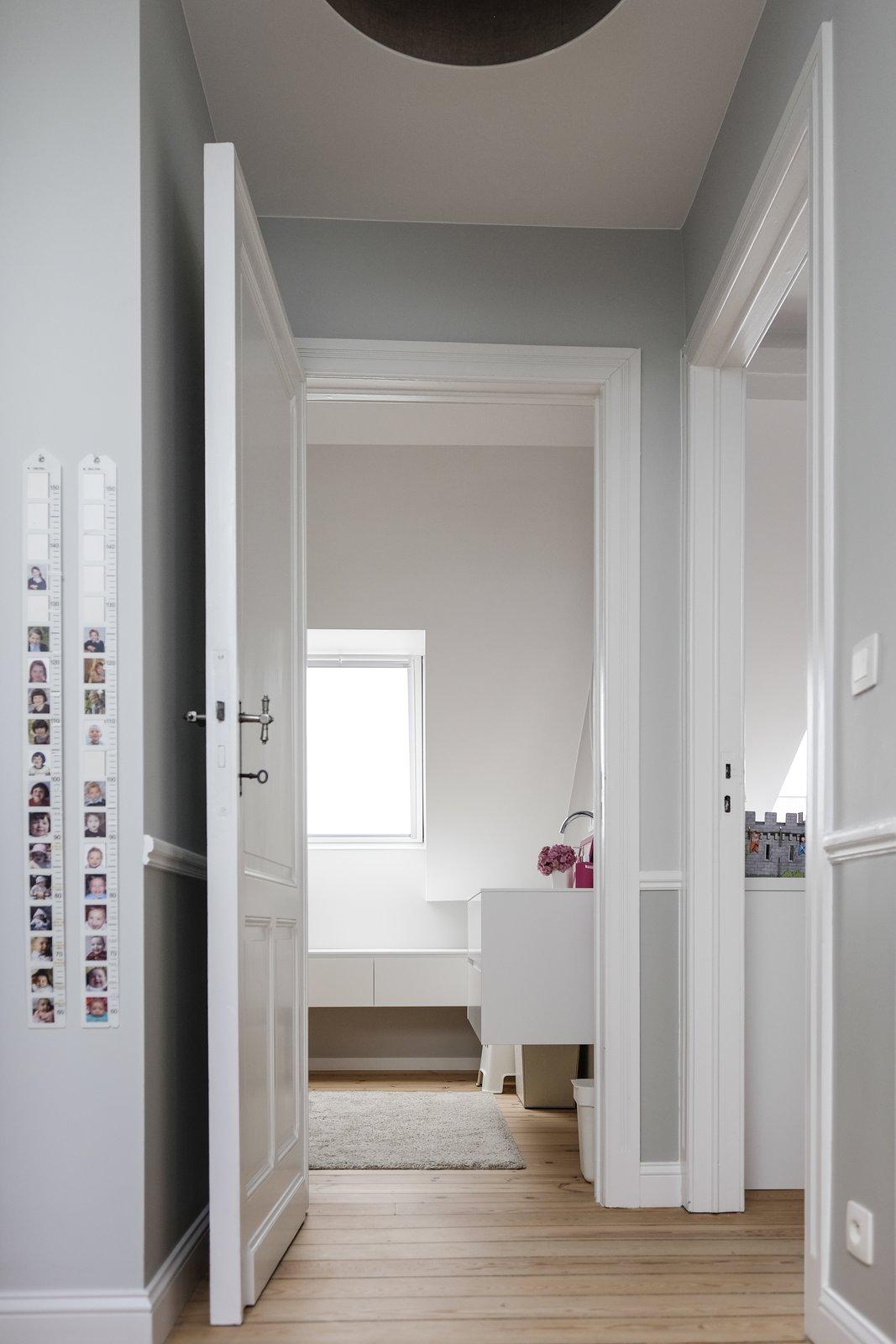 Bath, Light Hardwood, Ceramic Tile, Engineered Quartz, Drop In, Ceiling, and Enclosed The children floor  Best Bath Drop In Enclosed Ceramic Tile Photos from Maison de Maitre - Brussels