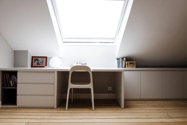 Bedroom, Ceiling Lighting, and Light Hardwood Floor One of the children bedroom  Best Photos from Maison de Maitre - Brussels
