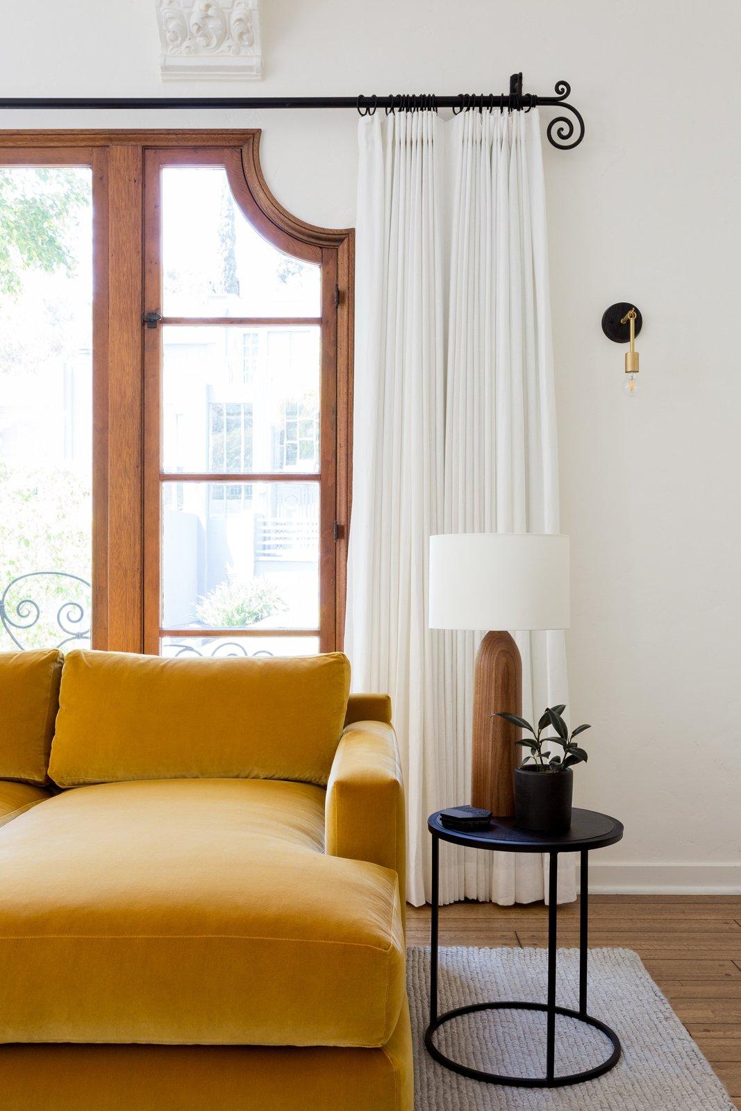 Living Room, Medium Hardwood Floor, Wall Lighting, Sofa, Table Lighting, and End Tables Living room  Dundee Residence by Jette Creative