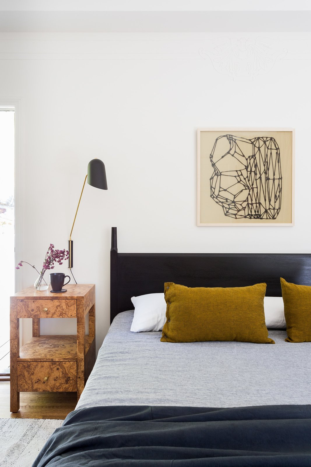 Bedroom, Wall Lighting, Bed, Medium Hardwood Floor, and Night Stands Master bedroom  Dundee Residence by Jette Creative