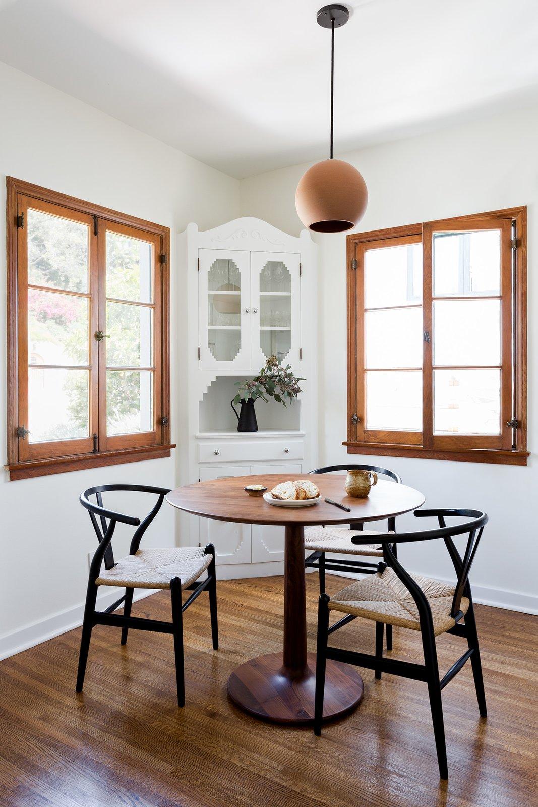Dining Room, Table, Storage, Medium Hardwood Floor, Pendant Lighting, and Chair Breakfast Nook  Dundee Residence by Jette Creative