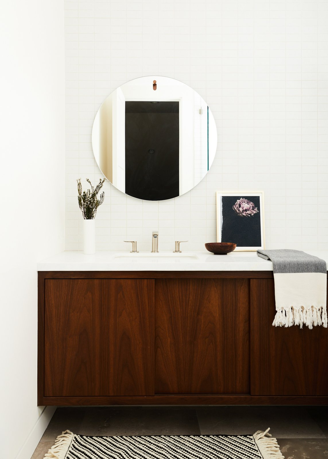 Bath Room, Undermount Sink, Subway Tile Wall, Marble Counter, and Ceramic Tile Wall Guest Bathroom  The Strand Residence