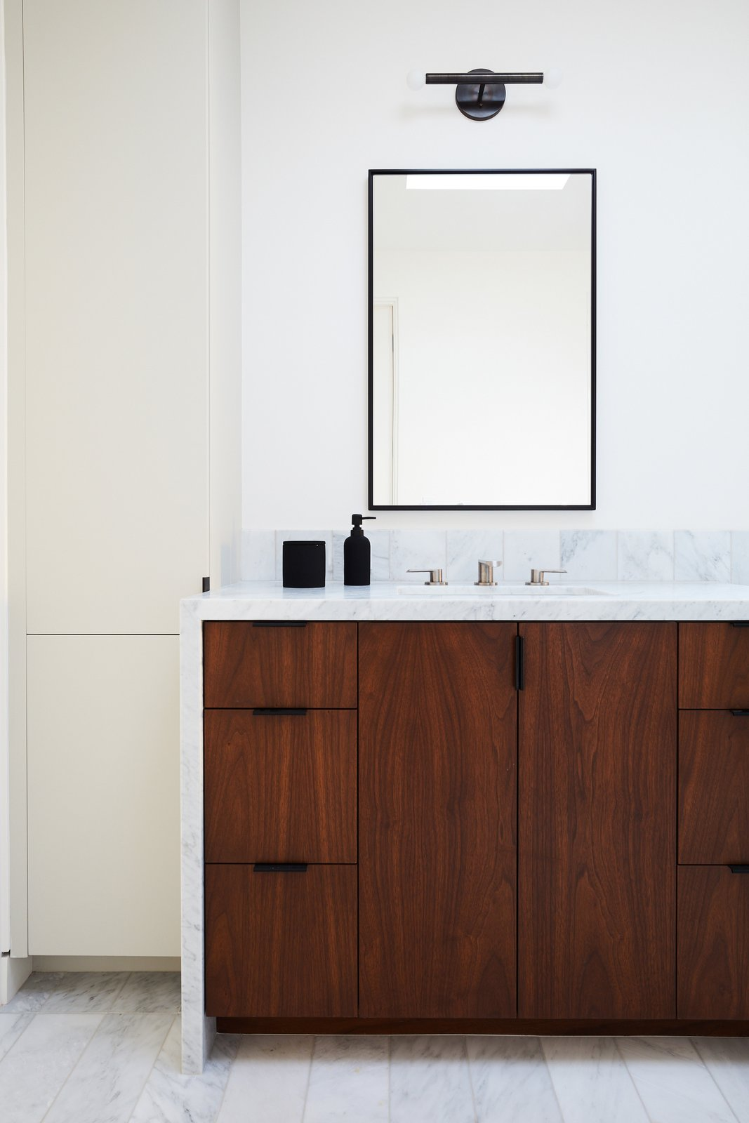 Bath Room, Wall Lighting, Marble Counter, Undermount Sink, and Marble Floor Primary Bathroom  The Strand Residence