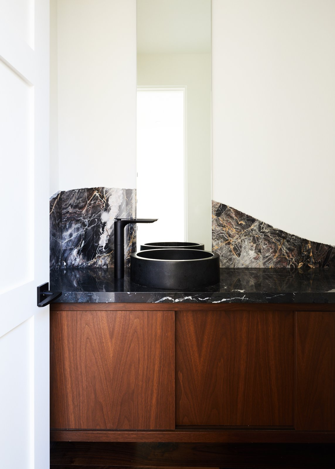 Bath Room, Stone Slab Wall, Vessel Sink, and Marble Counter Powder Bathroom  The Strand Residence