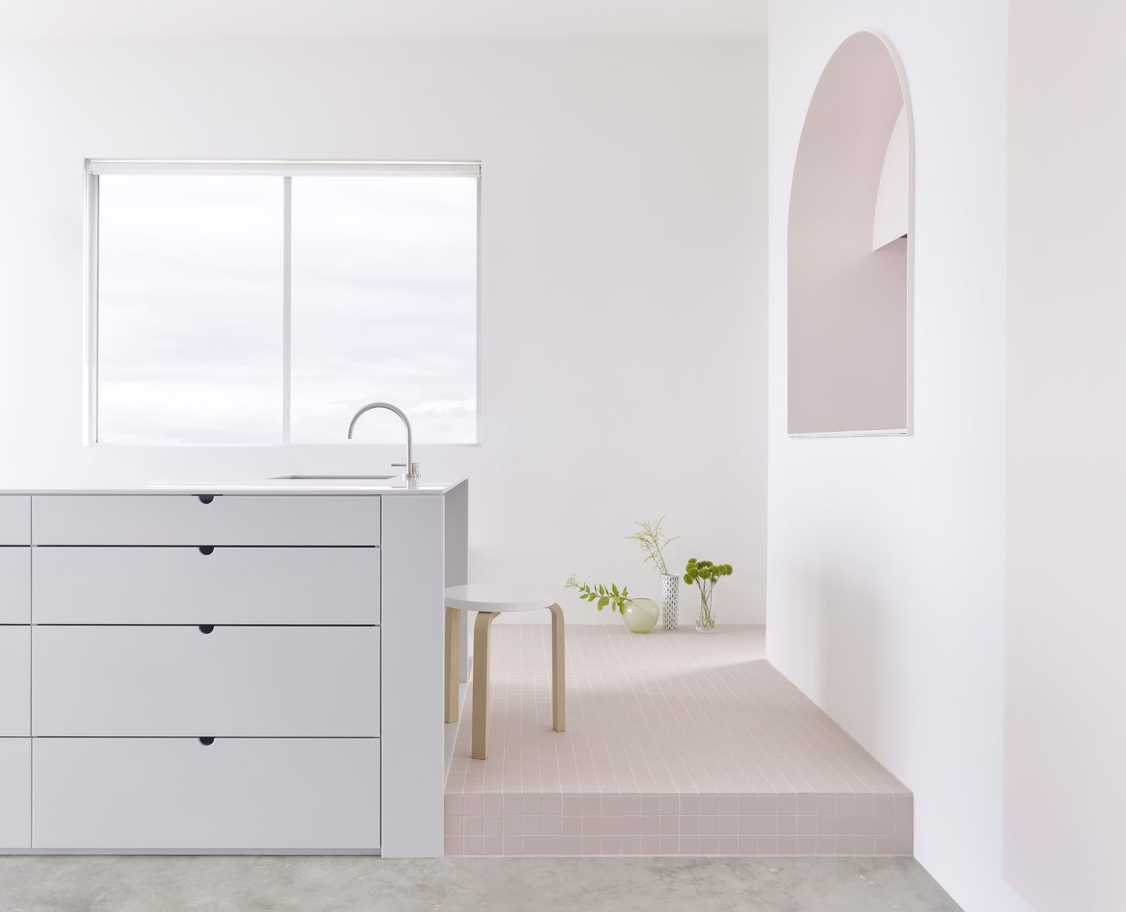 Elements: Grey corian bench, Japanese industrial tile plinth and pink 2-Pac door and reveal  Photo: Haydn Cattach  Photo 4 of 21 in The Pantone Choice: Top 10 Colors for Spring 2017 from Footscray Apartment, Melbourne Australia by BoardGrove Architects