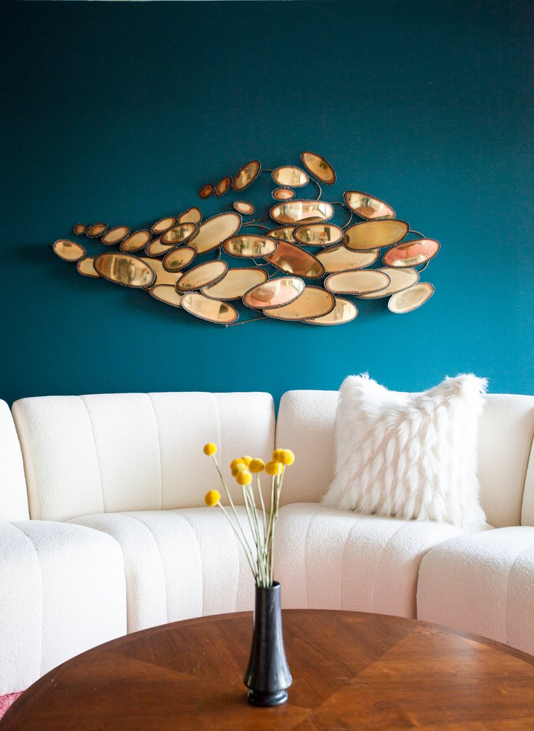 Living Room, Sectional, and Coffee Tables Blue is associated with calmness and dependability. Harking back to memories of the sky or the ocean,  it is seen as a color that promotes relaxation. This bold punch of teal combines the best of blue and green.  Photo 2 of 11 in These 5 Interior Design Trends Will Reign Supreme in 2018