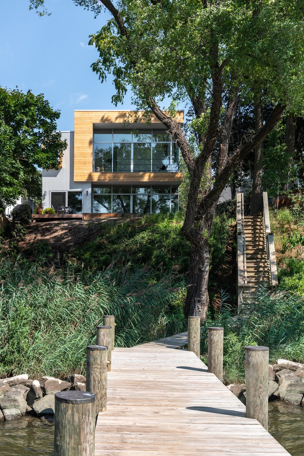 Exterior, Glass Siding Material, Metal Roof Material, Stucco Siding Material, Green Roof Material, Flat RoofLine, House Building Type, Wood Siding Material, and Metal Siding Material View from Boat Dock  Spa Creek House by GriD