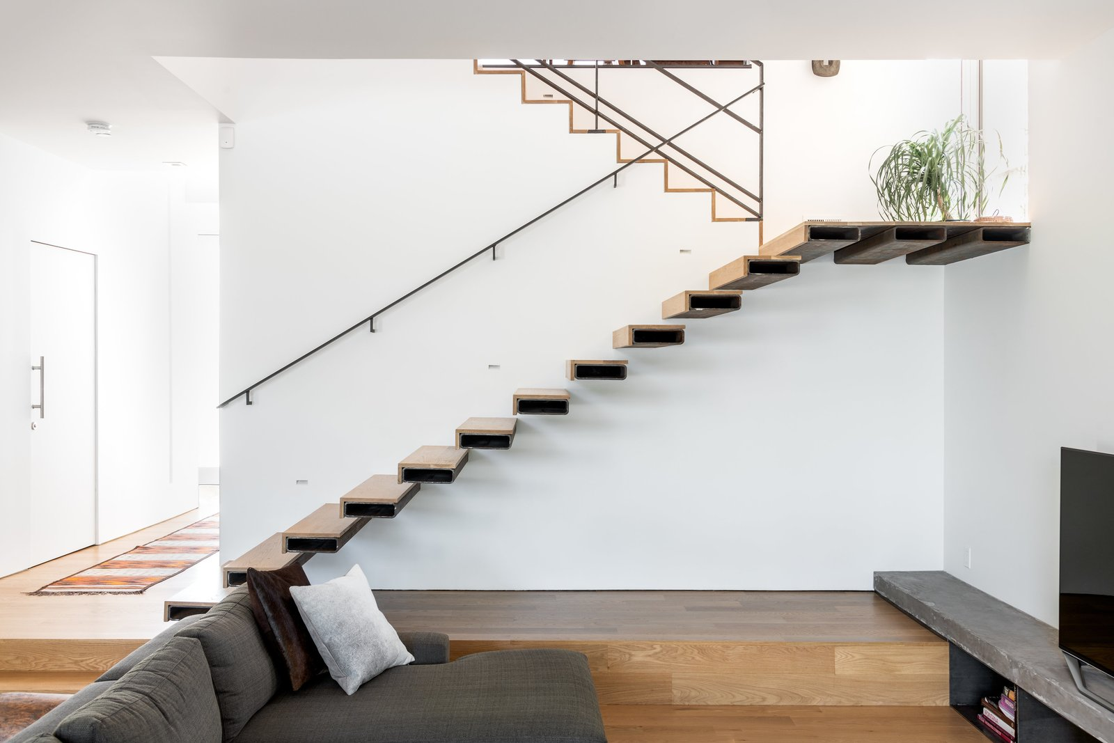 Staircase, Metal Tread, Metal Railing, and Wood Tread Stair Elevation  Spa Creek House by GriD