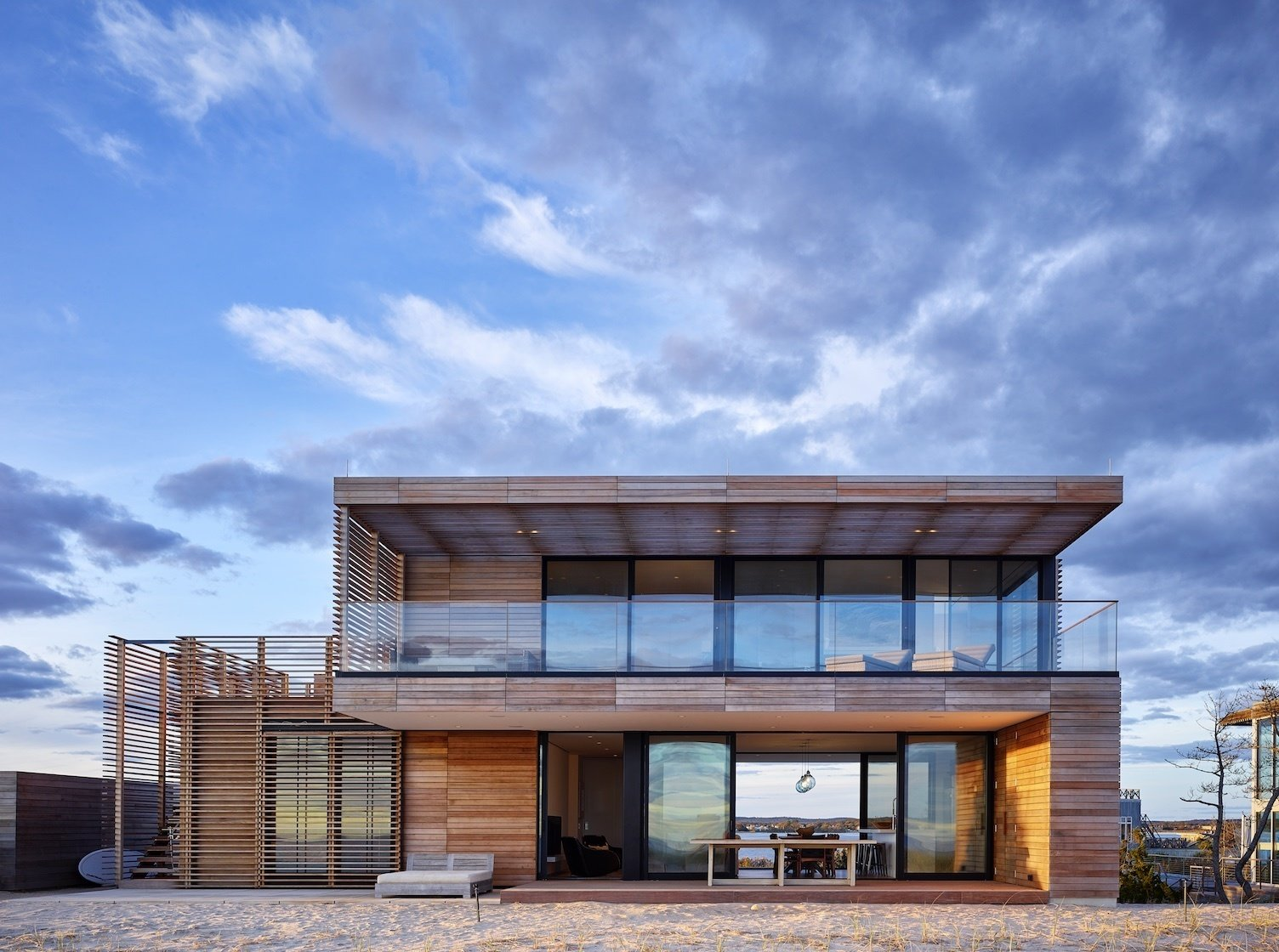 View from beach looking through to bay  House On The Point by Stelle Lomont Rouhani Architects