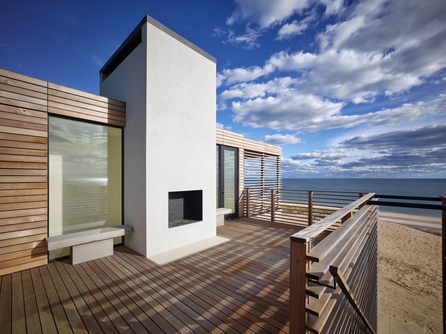 Upper deck with fireplace  House On The Point by Stelle Lomont Rouhani Architects