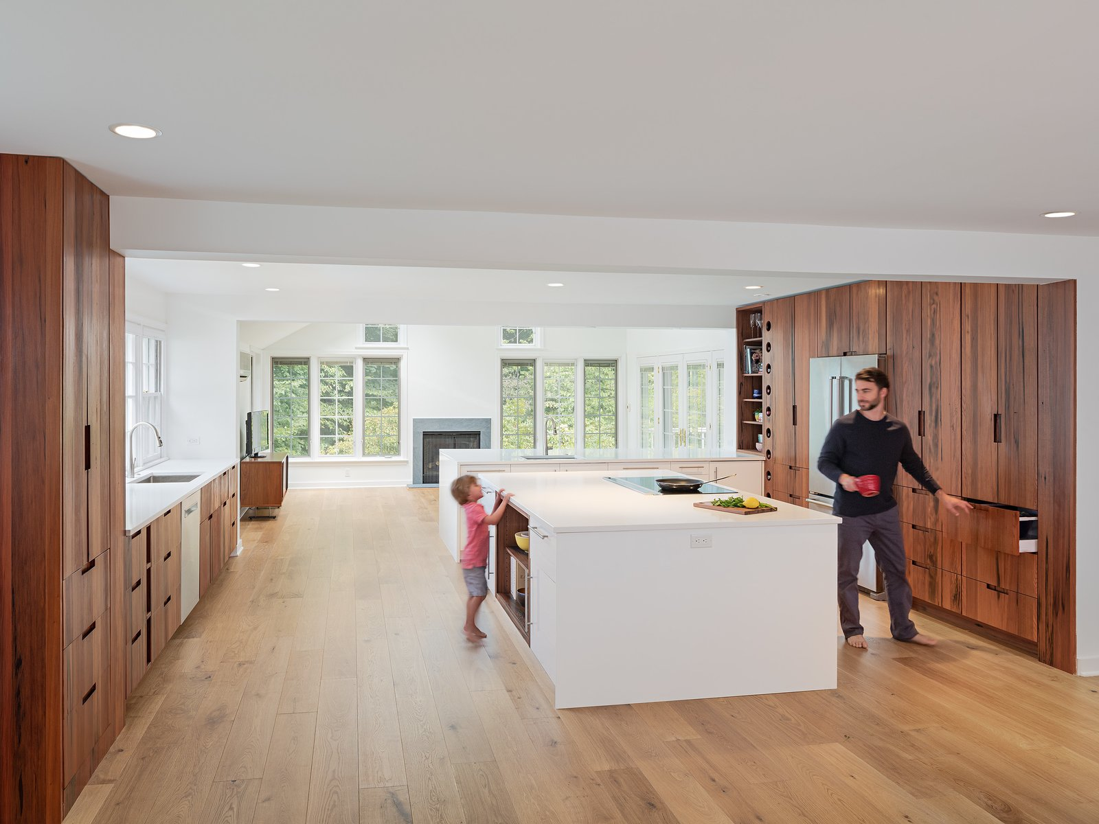 Kitchen, Engineered Quartz Counter, White Cabinet, Wood Cabinet, Recessed Lighting, Undermount Sink, and Light Hardwood Floor Custom cabinetry using Reclaimed American redwood with integrated pulls.  Wayne Residence