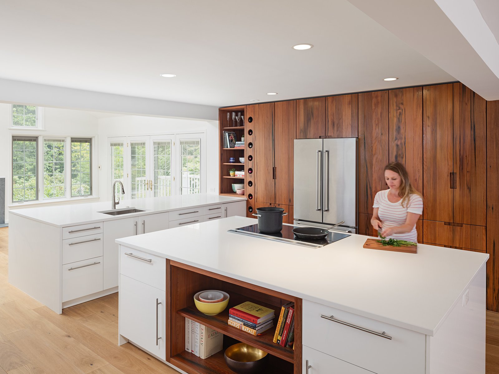 Kitchen, Refrigerator, Engineered Quartz Counter, White Cabinet, Wood Cabinet, Light Hardwood Floor, Recessed Lighting, and Undermount Sink Clean and open kitchen using high gloss white in combination with reclaimed American redwood  Wayne Residence