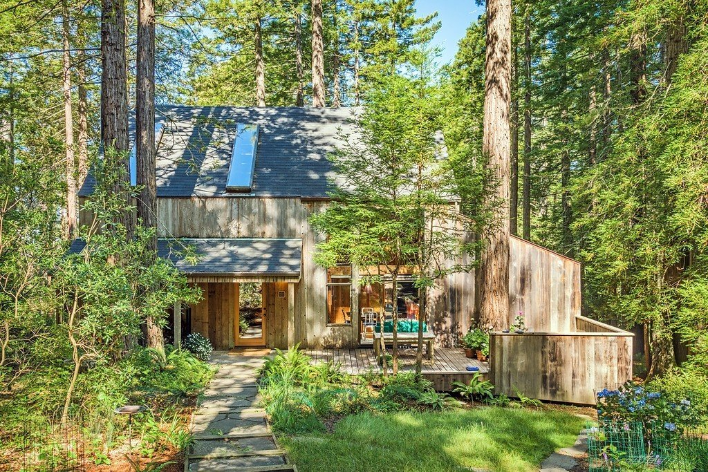 A view of the Abel House and its classic Sea Ranch design. With sloping rooflines and a naturally aged wood exterior, the minimalist aesthetic is meant to blend with nature.