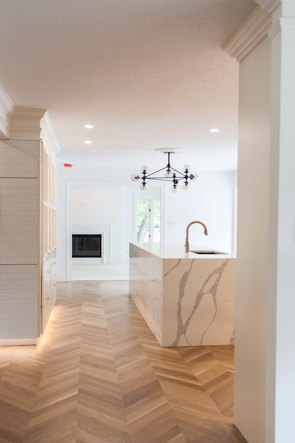 Kitchen, Engineered Quartz, White, Wood, Medium Hardwood, Light Hardwood, Laminate, Stone Slab, Ceiling, Floor, Accent, Recessed, and Undermount K I T C H E N  to L I V I N G   Kitchen Laminate Engineered Quartz Ceiling Photos from Brentwood