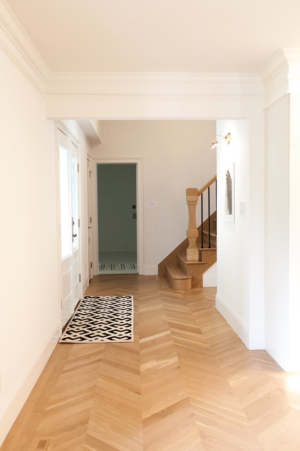Staircase, Wood Tread, and Wood Railing Custom milled flooring & newel post.  Brentwood