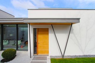 New entrance and glazed house extension and Japanese garden