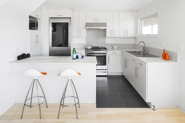 Neolith Countertops In The Open Kitchen And Details Like Flush Minimal Baseboard Contribute To