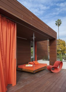 An outdoor swing bed makes the most of sunny, Santa Monica weather.