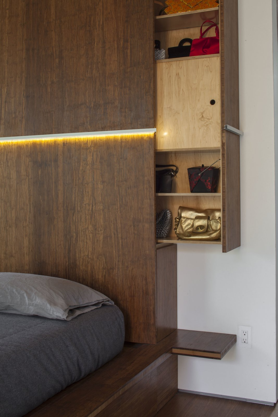 Bedroom, Bed, and Storage A pull-out console provides smart storage in the headboard.  Dawnsknoll by Minarc