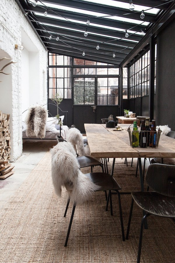 Though it's fully enclosed, this outdoor space serves as year round gathering area – even during the coldest of German winters.  Photo 5 of 10 in 10 Ways to Use Rugs in Your Outdoor Space This Spring