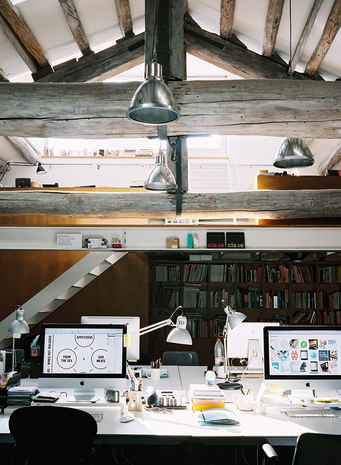 This multi-level attic is home to a creative firm that used the lower space for its production studio and the upper space for meetings or traditional work.  Photo 1 of 10 in 10 Ways to Create a Modern Workspace in Your Attic