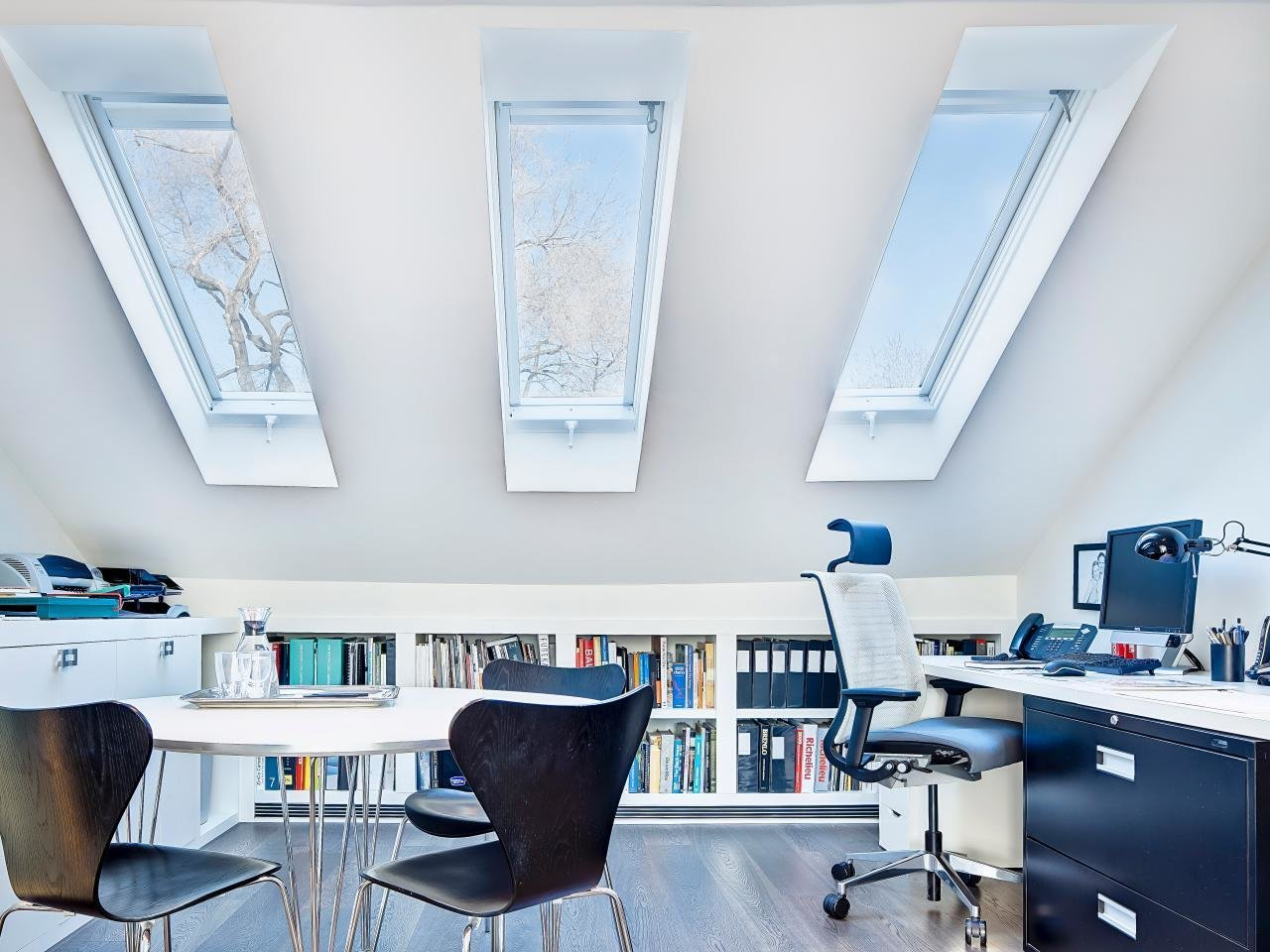 Lack of insulation and ventilation didn't prevent this Canadian attic from becoming a top-of-the line workspace for the townhouse's owners.  Photo 7 of 10 in 10 Ways to Create a Modern Workspace in Your Attic