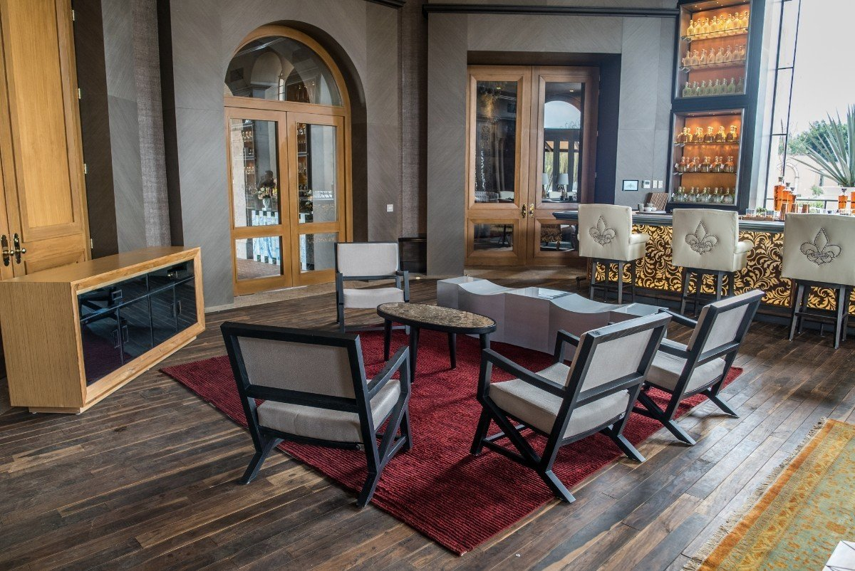 The floors are made from reclaimed wood found in the local region; the chairs are upholstered in American and Spanish textiles.  Photo 8 of 15 in Patrón Designed a Spanish Colonial Guest House with Modern Flair