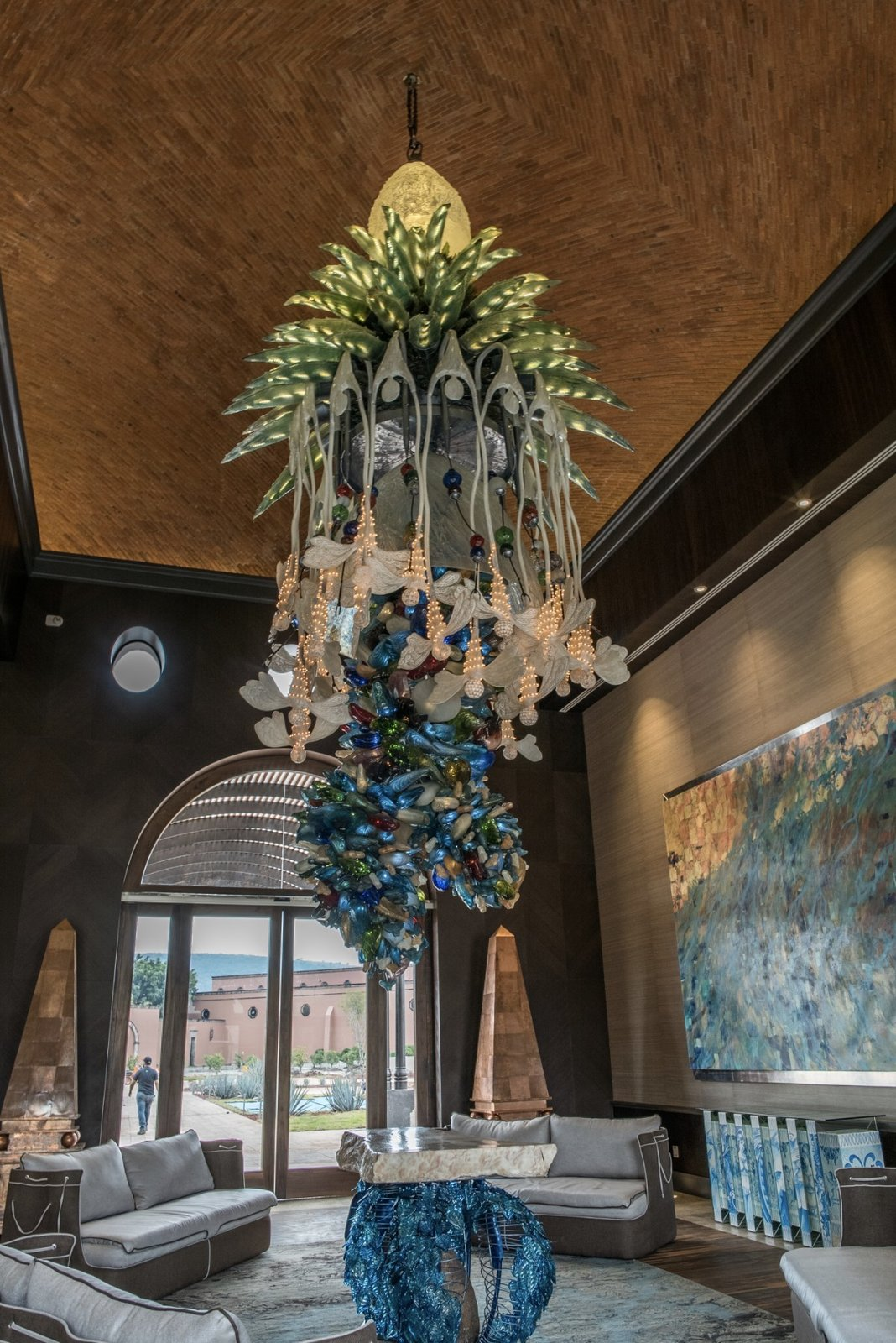 The reclaimed wood ceiling has agave bees carved into in order to represent their importance in the local production process for Tequila.  Photo 10 of 15 in Patrón Designed a Spanish Colonial Guest House with Modern Flair
