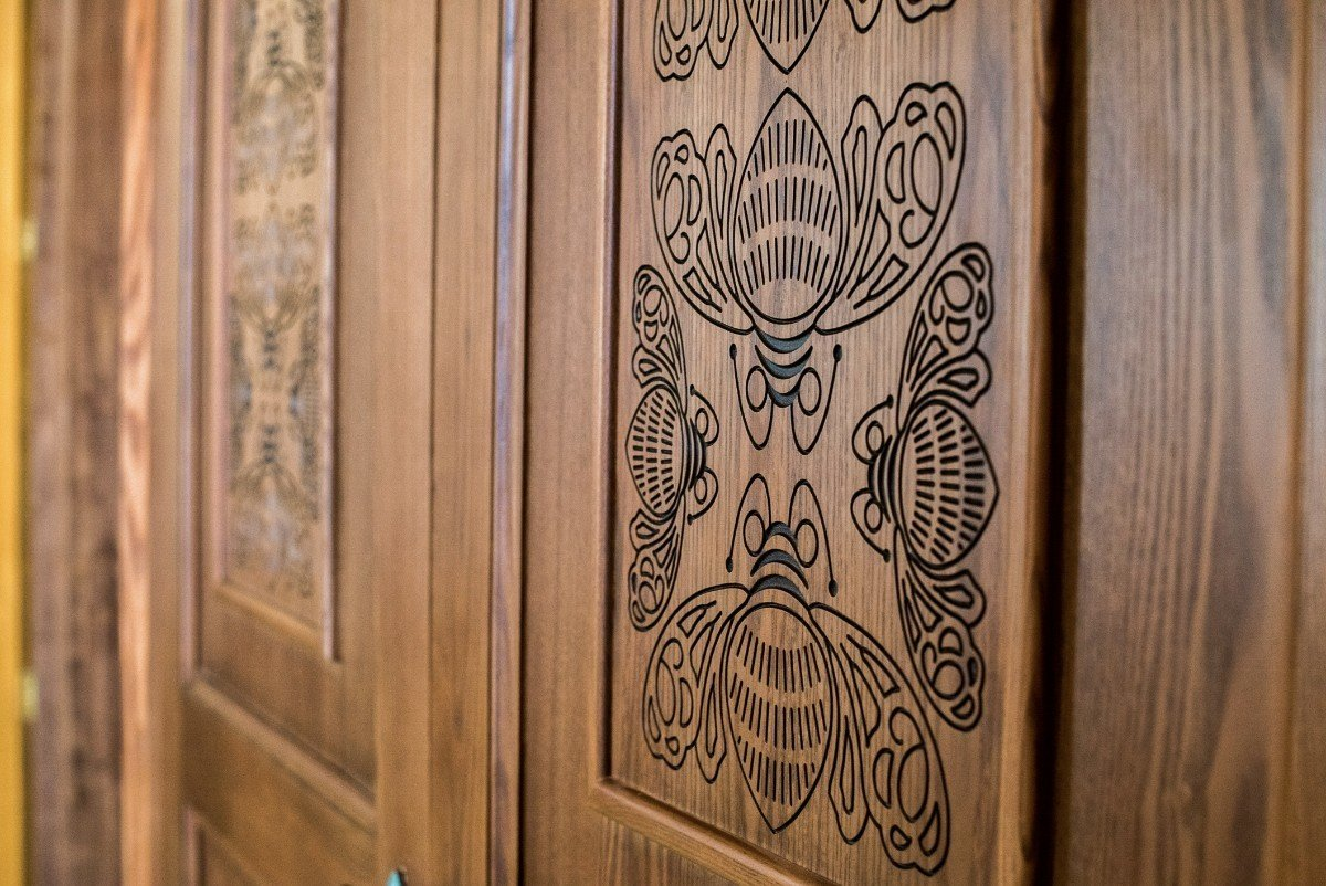 All the wood was hand carved by over 2,000 local artisans.  Photo 11 of 15 in Patrón Designed a Spanish Colonial Guest House with Modern Flair